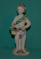 A Bow Porcelain Figure of Putto c.1765