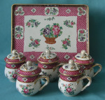 A French Porcelain Set of Five Custard Cups, Covers and Tray