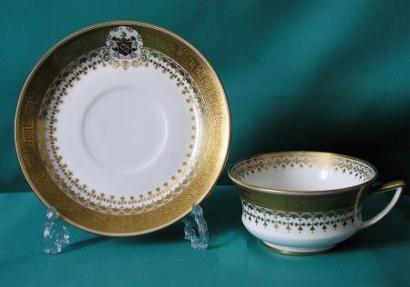 A Davenport Armorial tea cup and saucer c.1870
