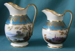 Two Minton Armorial Jugs