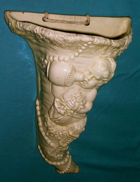 A late 18th century English creamware cornucopia wall pocket