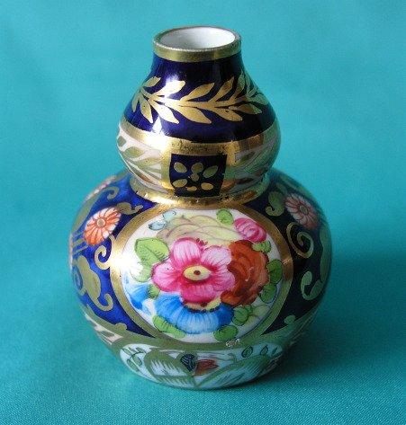 A Crown Staffordshire Miniature Vase c.1910