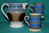 A pair of pearlware mocha decoration mugs c.1820